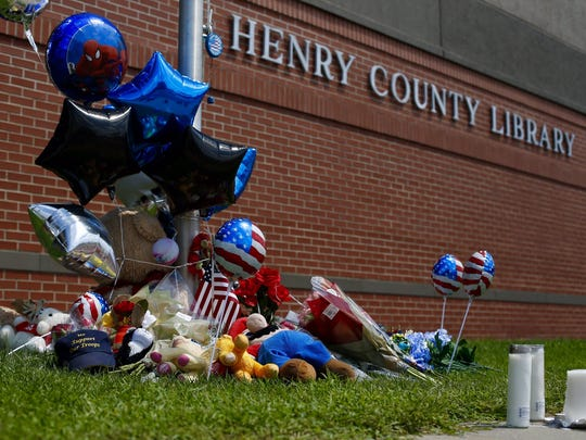 People are leaving items at a memorial for Clinton police officer Gary Michael.