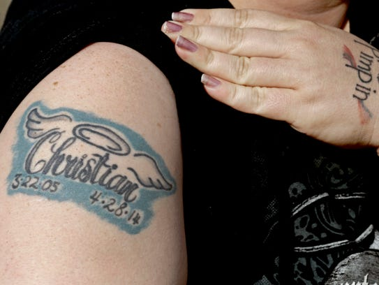 Amy Pittman shows a tattoo in remembrance of her son,