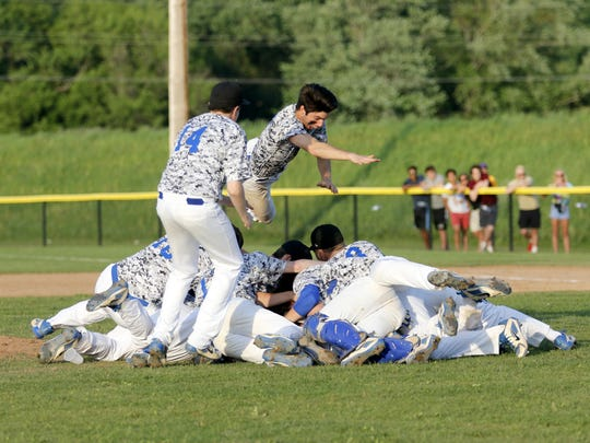 Horseheads players celebrate their clinching win over Corning on May 23 in the Section 4 Class AA baseball championship series at Corning-Painted Post High School.