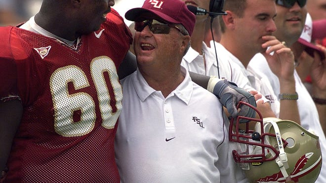 FSU offensive lineman Tarlos Thomas shares a smile with coach Bobby Bowden.   Democrat files Bobby Bowden and Tarlos Thomas, left, celebrate FSU's victory over Miami in 1999.