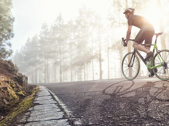 professional-cyclist-on-a-forest-road.jpg
