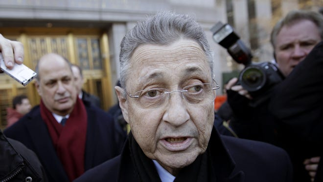 Then-Assembly Speaker Sheldon Silver is surrounded by media on Jan. 22 as he leaves a federal courthouse in New York City after his arrest on public corruption charges.