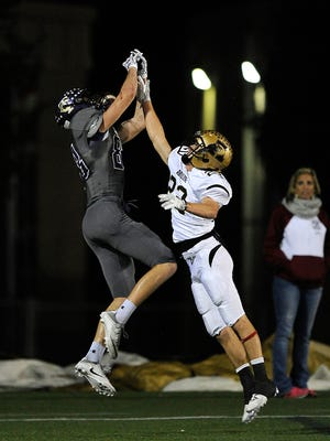 Abilene High defensive back Doak Holloway (22) breaks up a pass intended for Keller Timber Creek wide receiver Eric Mills (83) during the second quarter of the Eagles' 56-31 win on Thursday, Nov. 3, 2016, at Keller Athletic Complex.