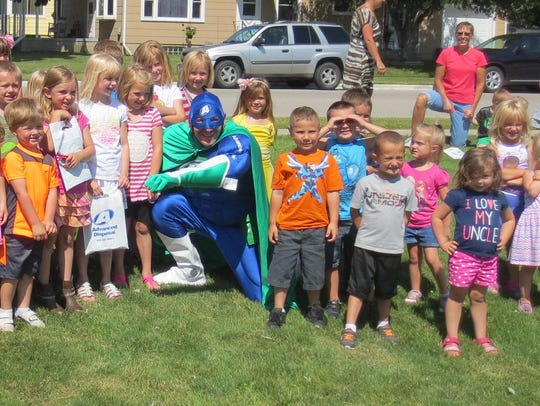 Eco Man from Advance Disposal visited with the children