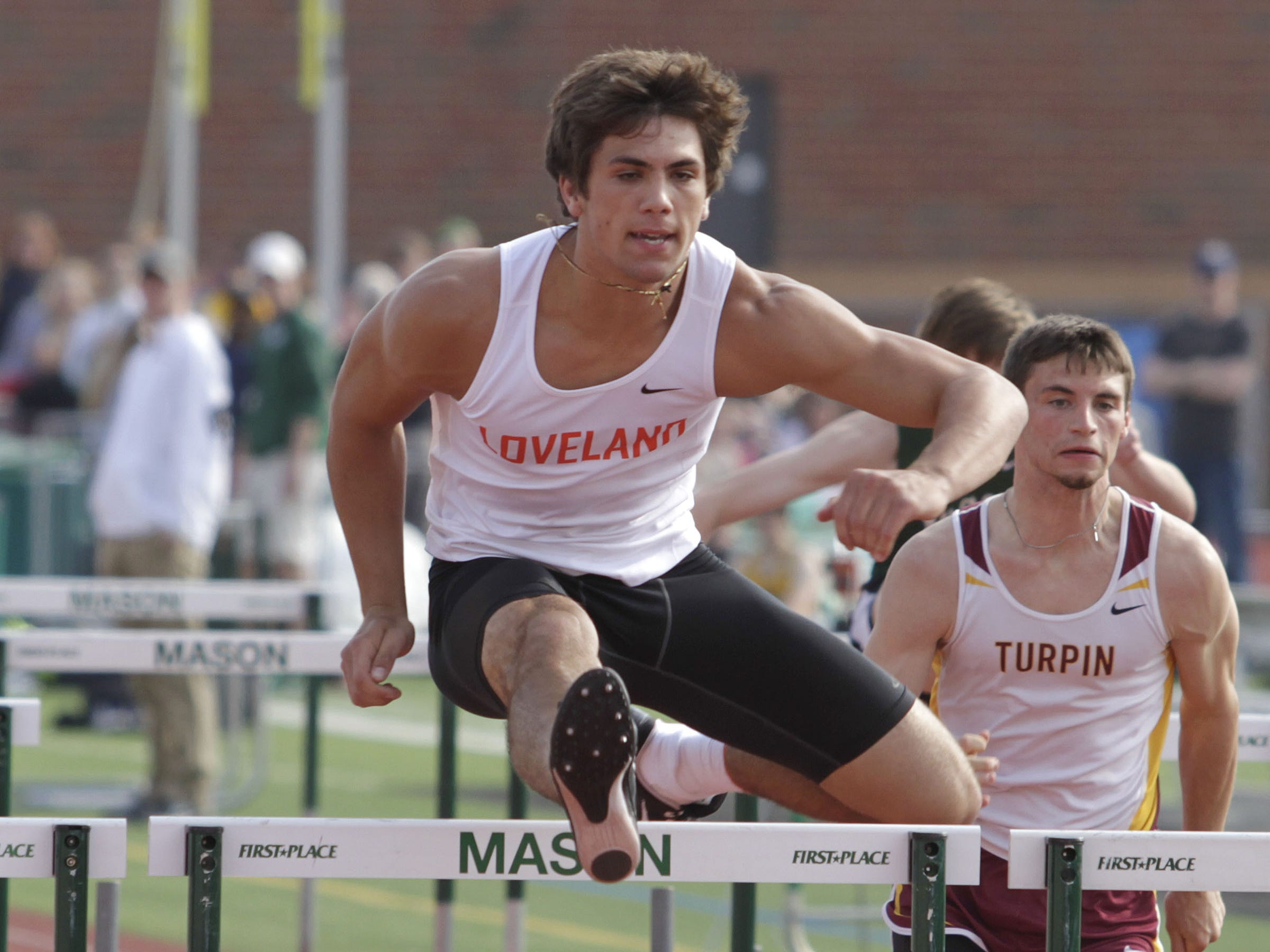 Giovanni Ricci of Loveland breezes to a first-place finish in the 110 meter hurdles for the Tigers.