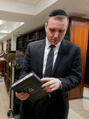 Moshe Gleiberman, vice president of administration, talks about gives a tour of one of the libraries inside the Israel Henry Beren Hall at Beth Medrash Govoha in Lakewood, NJ Wednesday, February 7, 2018.