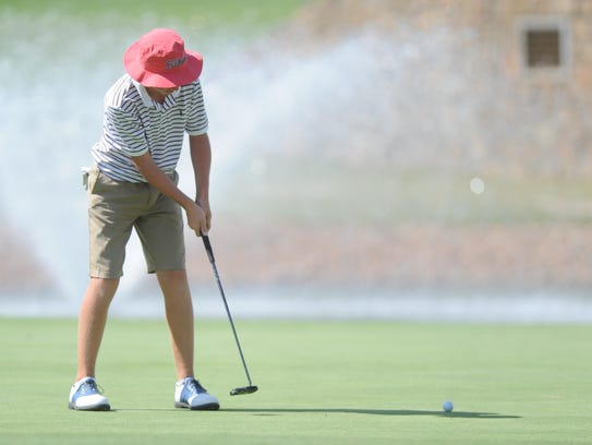 Abilene's Karson Grigsby, 13, watches his putt at hole