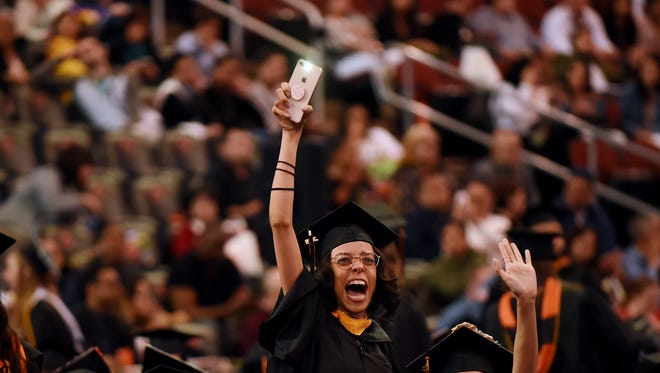 This graduate clearly could not contain her jubilation at William Paterson's commencement ceremony.