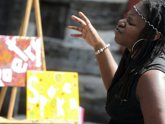 Poet Glori Morris-Carter of Baltimore performed at