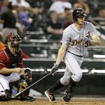Jul 23, 2014; Phoenix, AZ, USA; Detroit Tigers third baseman Don Kelly (32) singles in the fourth inning against the Arizona Diamondbacks at Chase Field.