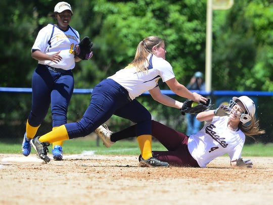 Snow Hill's Lauren Smith gets tagged out at third against