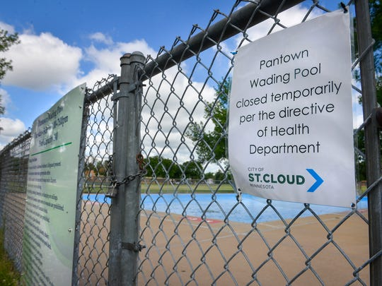 A sign at the Pantown wading pool tells the public that the pool has been closed after a directive of the health department.