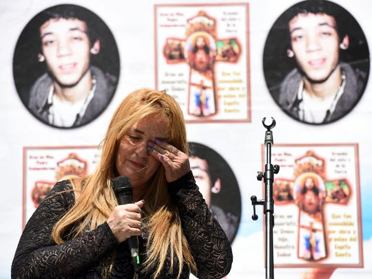 Cecilia Luna-Diaz wipes away a tear while speaking during a memorial ceremony for her son, Elvin Diaz, on the second anniversary of his death in Hackensack.