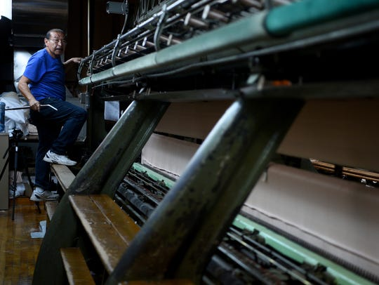 Edgar Acosta of Clifton is up and down on the loom