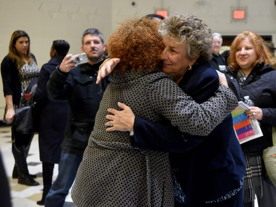 Eileen Shafer is hugged by a supporter in February.
