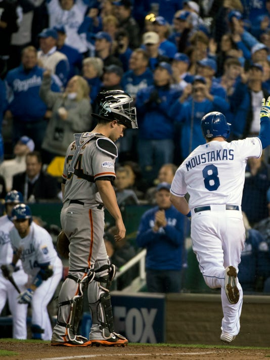 Kansas City Royals Mike Moustakas crosses home plate after hitting a solo home run off San Francisco Giants relief pitcher Hunter Strickland  in the bottom of the sixth inning of Game 6 of baseball's World Series Tuesday, Oct. 28, 2014, in Kansas City, Mo. (AP Photo/The Sacramento Bee, Jose Luis Villegas)  MAGS OUT; LOCAL TELEVISION OUT (KCRA3, KXTV10, KOVR13, KUVS19, KMAZ31, KTXL40); MANDATORY CREDIT
