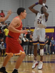 Louisiana State University at Alexandria's Brandon Moss (21, right) shoots over University of St. Thomas defenders Thursday, Jan. 12, 2018 at the Fort.