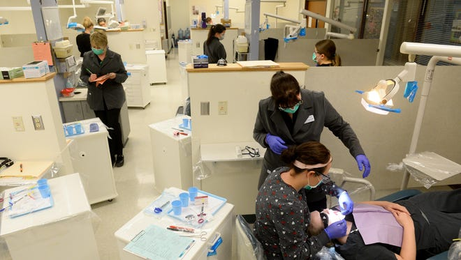 Great Falls College-MSU dental hygiene students practice their oral injections on Wednesday.