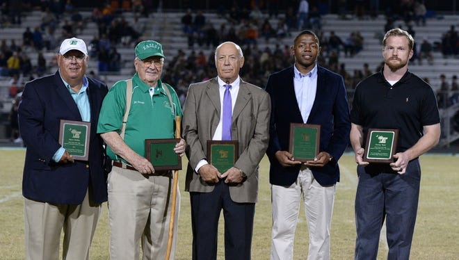 Dave Giffin, Lucile Cisson Stewart, Tommy Nix, Chris Talley and Corey Tant were inducted into the Easley High School Athletic Hall of Fame at halftime of Easley's football game against T.L. Hanna Sept. 30. Pictured are, from left, Giffin, Jim Stewart (son of Lucile Cisson Stewart), Nix, Talley and Tant.