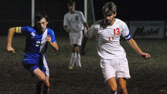 Zane Trace's Andrew Stauffer rushes past a defender earlier this season in an SVC contest versus Southeastern in Kinnikinnick. Stauffer's Pioneers made history this year by winning the first ever boys soccer SVC title.