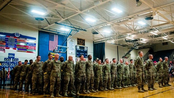 More than 150 Michigan Army National Guard soldiers of the 144th Military Police Company return home from Afghanistan on  Jan. 23 at Owosso High School in Owosso, Mich. A Pentagon report issued Friday called for uniform standards in monitoring medication use by troops wounded in combat.