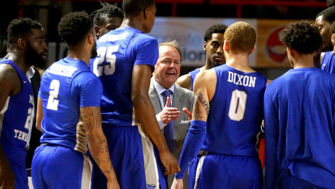 MTSU coach Kermit Davis talks with his team during a timeout during the game against Western Kentucky on Saturday.