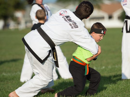 2nd grader Von Kleiv (7) performs during a karate demonstration at Laps For Lymphoma fundraiser at Major George S. Welch Elementary School on Dover Air Force Base. Von was diagnosed with lymphoma in 2016.