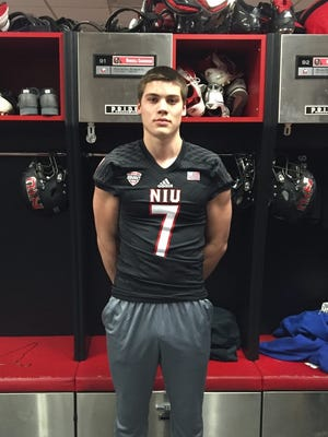 Bay Port linebacker Matt Lorbeck in the Northern Illinois University football team's locker room during a visit earlier this year. Lorbeck made a verbal commitment to Northern Illinois on Sunday.