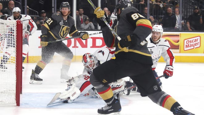 Braden Holtby of the Washington Capitals makes a diving stick-save on Alex Tuch of the Vegas Golden Knights during the third period of Game 2.