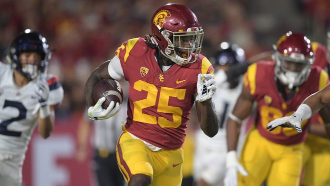Southern California Trojans running back Ronald Jones II (25) carries the ball against the Arizona Wildcats in the second quarter during an NCAA football game at Los Angeles Memorial Coliseum.