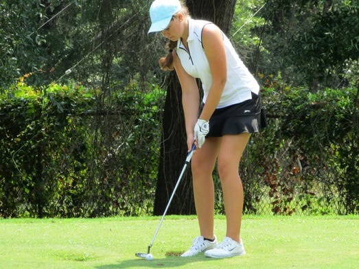 Abigail Herrmann sinks a putt on Tuesday at the second round of the Divit Derby at A.C. Read golf course on Pensacola NAS.