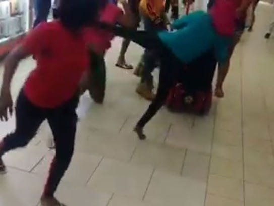 A brawl involving a group of people at the Edison Mall