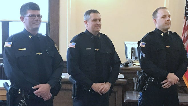 Elmira police Capt. John Perrigo, left, Lt. Zachary Stewart, center, and Sgt. Christopher Osiecki take part in a promotion ceremony Friday.