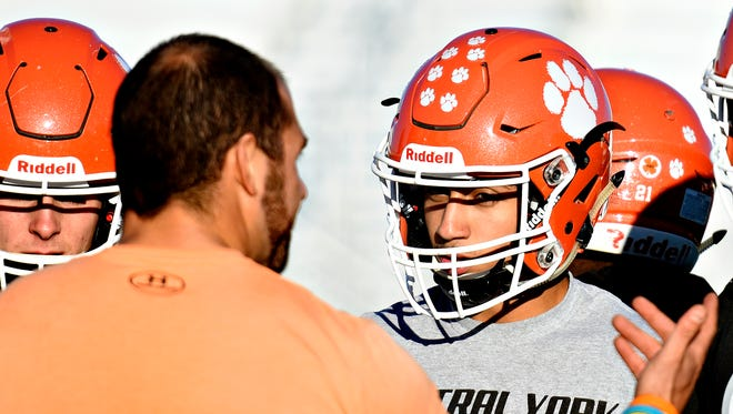Central York's defensive back Jordan Bowie right, looks on as defensive coordinator/defensive line coach Mike Cesarano speaks during football practice at the school in Springettsbury Township, Monday, Oct. 10, 2016. Dawn J. Sagert photo