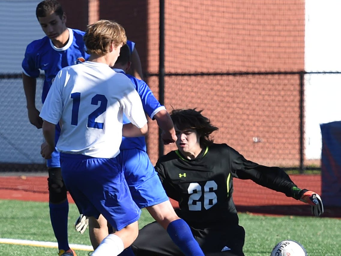 Millbrook's Zeke Kopilak scores on Chester's Michael Moore during Monday's sectional semifinal game.