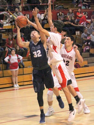 Alex Marquez gets fouled as he goes toward the hole. He finished with 15 points to help Silver pick up the win against rival Cobre High on Tuesday night.