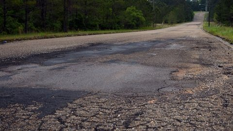 Lamar Boulevard is one of the 28 percent of roads in Hattiesburg that are in poor condition. Pine Belt county supervisors and engineers are invited to a Dec. 8 meeting with state officials to draw attention to Mississippi's aging roads and bridges.