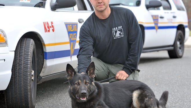 Vineland K-9 officer Louis Platania with K-9 Agir in a December 2014 file photo.