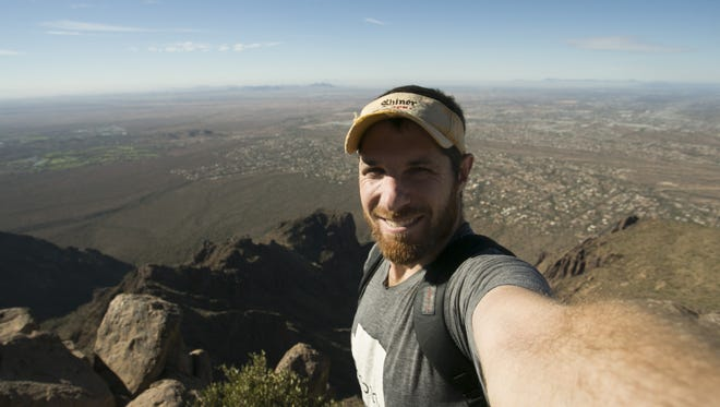 Arizona Republic photographer David Wallace takes a selfie on the top of the Flatiron in the Superstition Mountains. The route climbs 3,000 vertical feet.