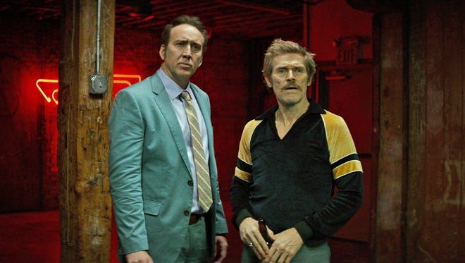 """Troy (Nicholas Cage) and Mad Dog (Willem Dafoe) are two members of a gang about to embark on their biggest and final job in """"Dog Eat Dog."""""""