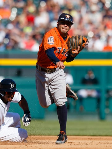 Astros second baseman Jose Altuve makes a throw to