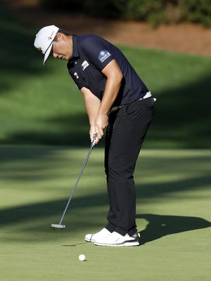 Sungjae Im putts on No. 10 during the third round of the Masters Tournament on Saturday. The Korean, playing in his first Masters, is tied for second heading into the final round.