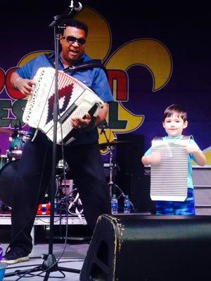 My son, Dylan, onstage with Chubby Carrier at the Scott Boudin Festival on April 1.