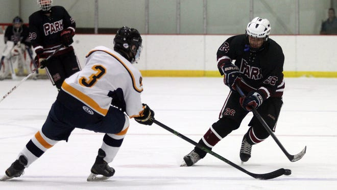 Jefferson's Nick King (3) defends as Park Regional's Sal Simeone looks to pass during their ice hockey matchup at Skylands Ice World. December 12, 2015, Stockholm, NJ.