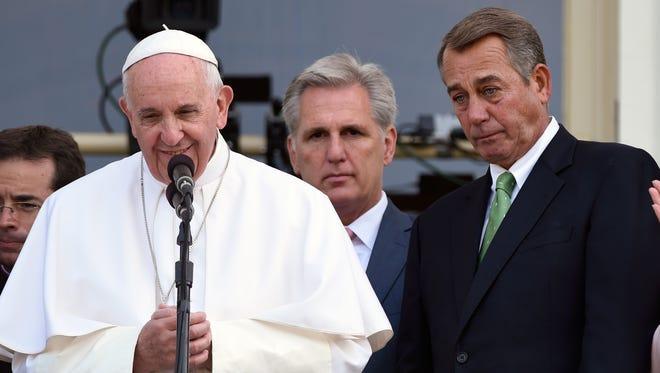 House Speaker John Boehner of Ohio becomes emotional as Pope Francis appears on the Speaker's Balcony on Capitol Hill Thursday.