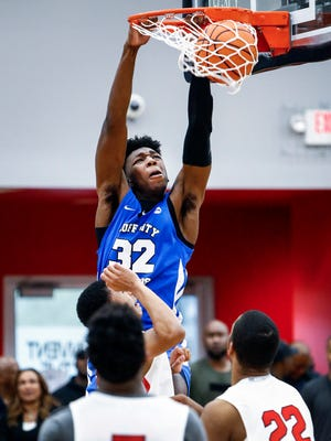 Bluff City Legends center James Wiseman (top) dunks over the PSA Cardinals defense during their Nike EYBL game in Dallas, Texas.