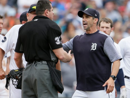 Detroit Tigers' Brad Ausmus, right, talks with home plate umpire Carlos Torres after Detroit's James McCann was hit by a pitch during the seventh inning of a baseball game against the New York Yankees on Thursday, Aug. 24, 2017, in Detroit. The Tigers won 10-6.