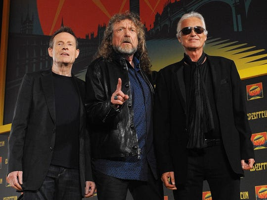 Robert Plant, flanked by surviving Led Zeppelin members