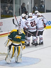 St. Cloud State players celebrate one of three first period goals against University of Regina goaltender Michael Herringer during the Saturday, Sept. 30, exhibition game at the Herb Brooks National Hockey Center in St. Cloud.