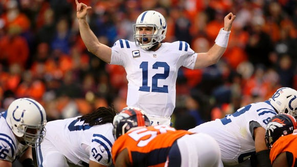 Colts quarterback Andrew Luck gestures before a snap